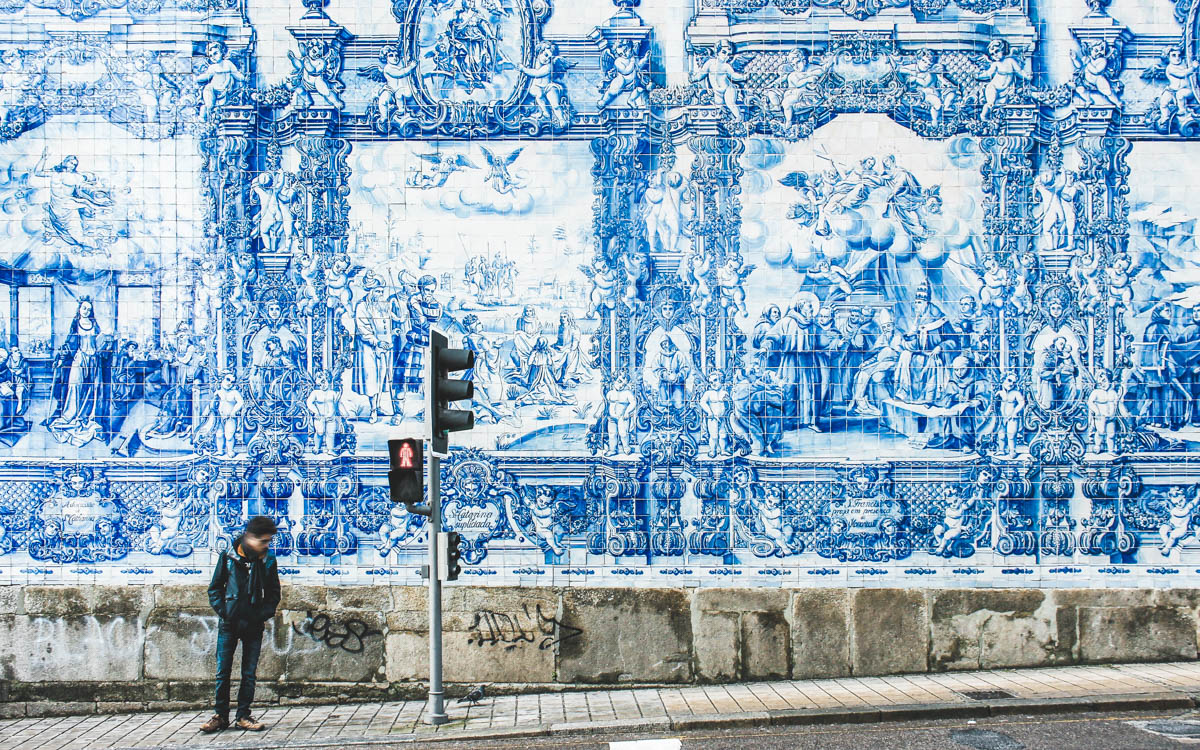 wall with azulejos, blue and white portuguese mosaic in porto portugal